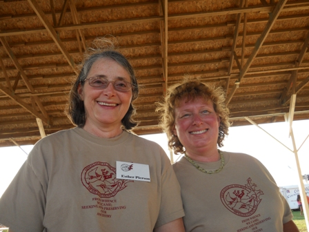 Two members of the Genealogical Society's ice cream making team model their society t-shirts.